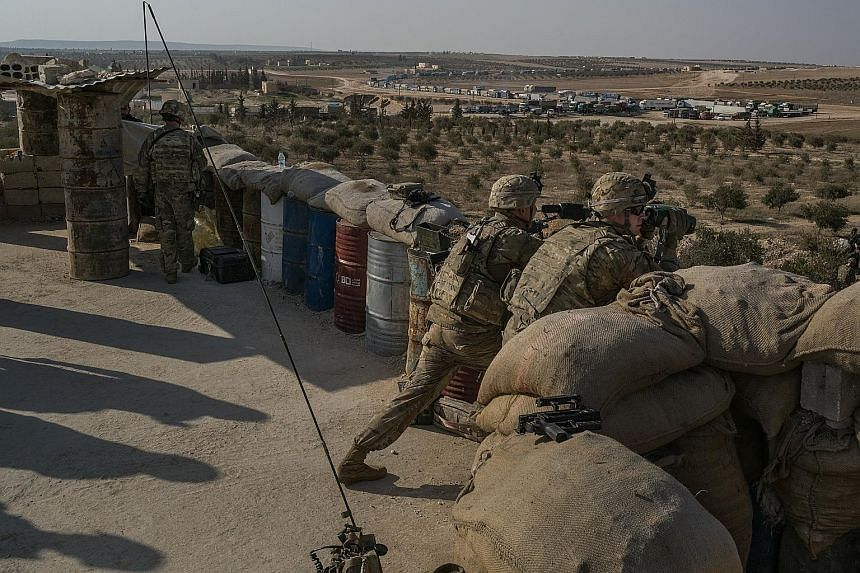 US special forces at an outpost outside the north-western Syrian town of Manbij in February. The US has pulled out all the soldiers it had there.