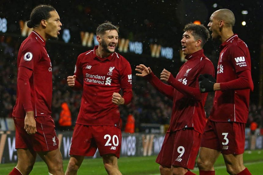 Liverpool players celebrate after scoring their second goal during the English Premier League football match between Wolverhampton Wanderers and Liverpool, on Dec 21, 2018.