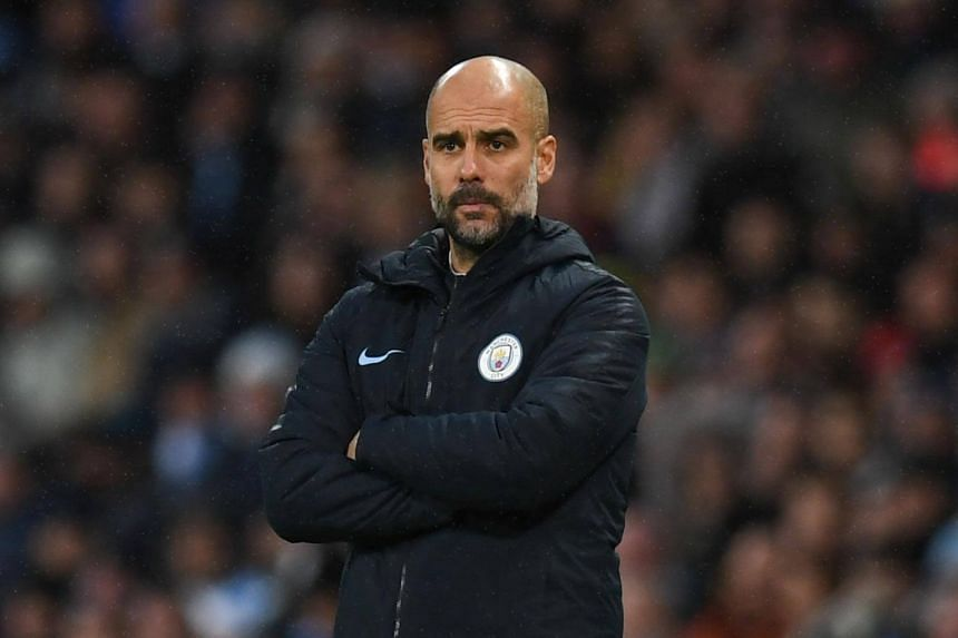 Manchester City's Spanish manager Pep Guardiola watches from the touchline during the English Premier League football match between Manchester City and Crystal Palace, on Dec 22, 2018.