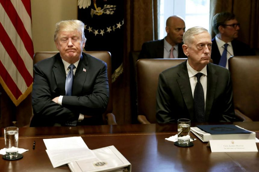 President Donald Trump and Defence Secrertary Jim Mattis sit next to each other during a Cabinet meeting at the White House on June 21, 2018.