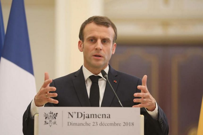 France's president Emmanuel Macron holds a press conference at the presidential palace in N'Djamena, on Dec 23, 2018.