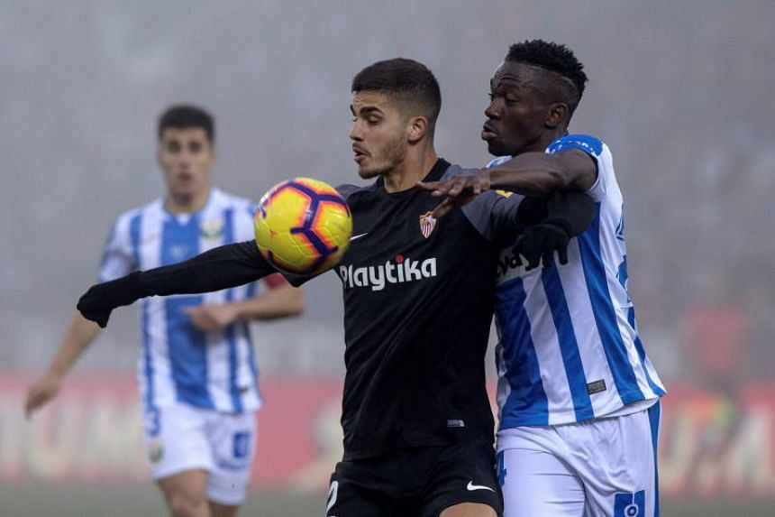 CD Leganes' defender Kenneth Omeruo (right) duels for the ball with Sevilla CF's Andre Silva during their Spanish Liga Primera Division soccer match played at Butarque stadium in Leganes, Madrid, Spain, on Dec 23, 2018.