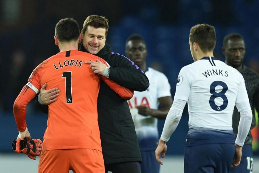 Tottenham Hotspur's Argentinian head coach Mauricio Pochettino (seond left) celebrates with French goalkeeper Hugo Lloris (left) and English midfielder Harry Winks after the final whistle of the EPL match between Everton and Tottenham Hotspur at Good