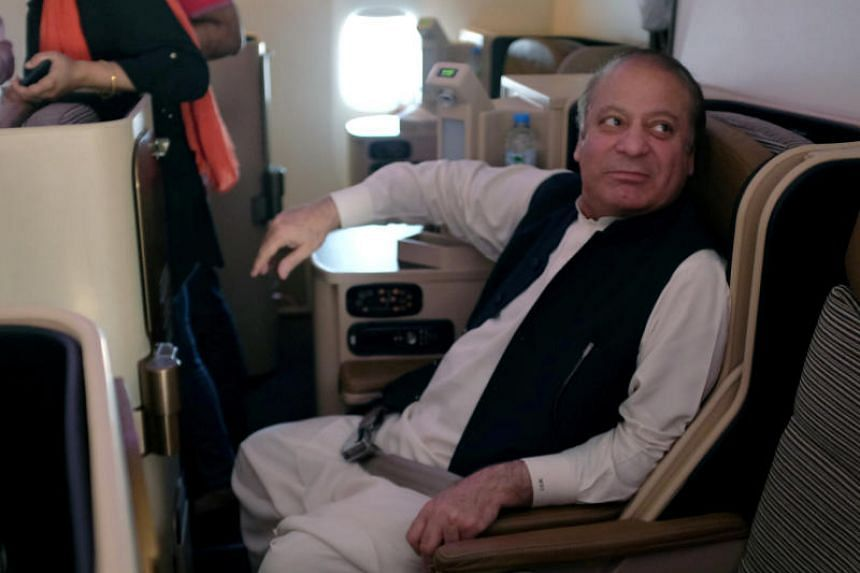 Ousted Pakistani Prime Minister Nawaz Sharif on a plane after landing at the Allama Iqbal International Airport in Lahore, Pakistan, on July 13, 2018.