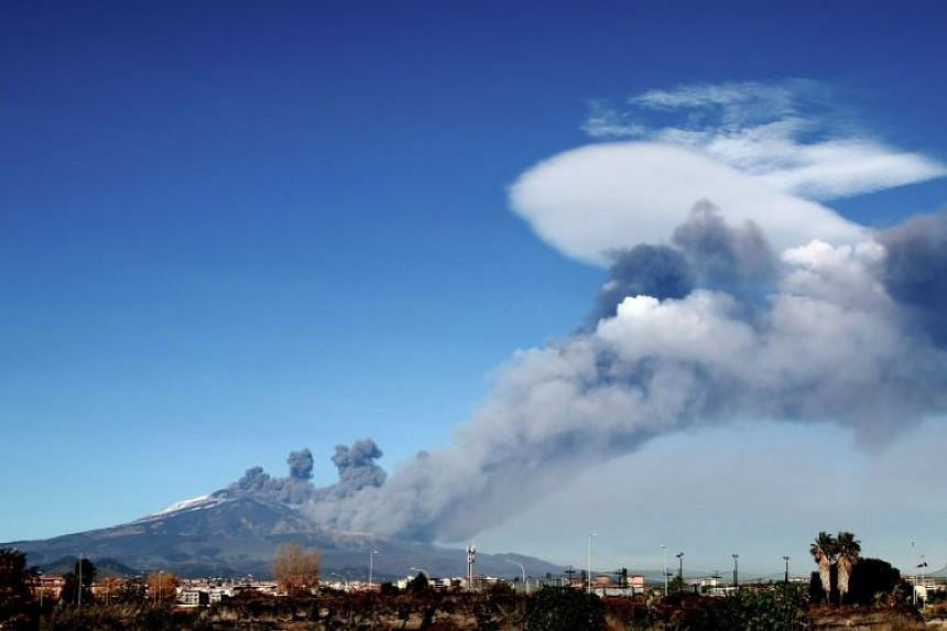 Smoke rises over the city of Catania during an eruption of Mount Etna, one of the most active volcanoes in the world on Dec 24, 2018.