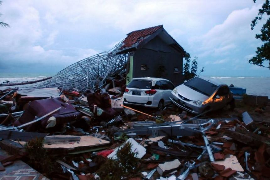 Debris from damaged buildings and cars are seen near the beach in Anyer, Serang on Dec 23, 2018.