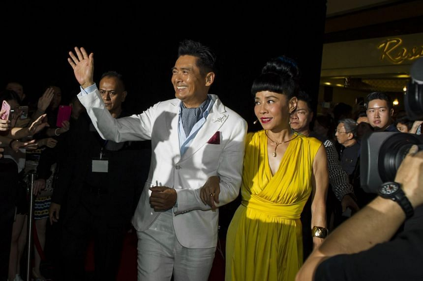Hong Kong movie star Chow Yun Fat with his Singaporean wife Jasmine attend a gala premiere at The Shoppes at Marina Bay Sands on July 5, 2016.