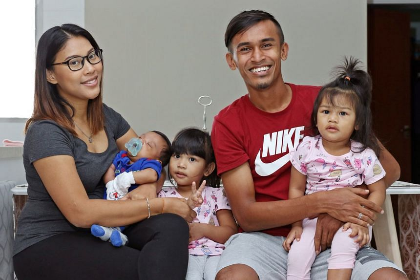 Shakir Hamzah the reformed family man with wife Erni Maulood, two-month-old son Noah Uwais Sharel and daughters Emily Aisyah, two, and Estelle Aisyah, one.
