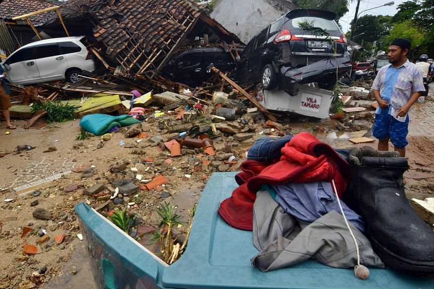 The trail of damage left by the tsunami in Carita, in Indonesia's Banten province, yesterday. The 2m- to 3m-high waves hit locations in Banten province, on the western tip of Java, and Lampung province, in southernmost Sumatra, on Saturday night.