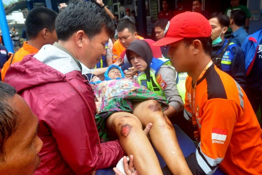 An injured tsunami victim being transferred to an ambulance yesterday.