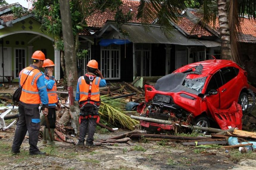 Rescuers look for victims at a damaged home in Carita, on Dec 23, 2018.