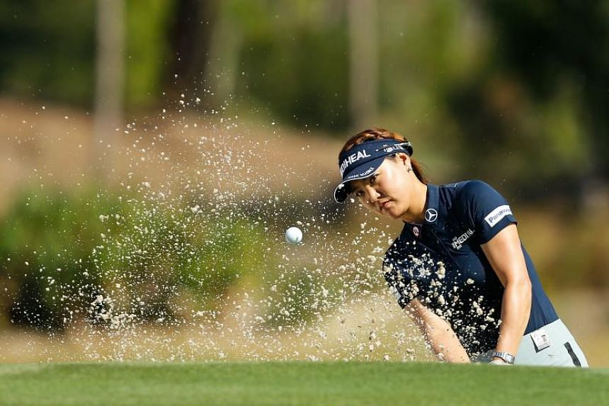 South Korea's Ryu So-yeon plays a shot from a bunker on the ninth hole during the CME Group Tour Championship at Naples, Florida on Nov 14, 2018.