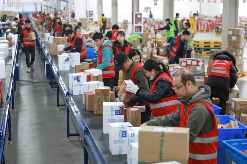 Workers preparing items ahead of a shopping festival at a storage facility in Shenyang, Liaoning province, China, on Nov 9, 2018.