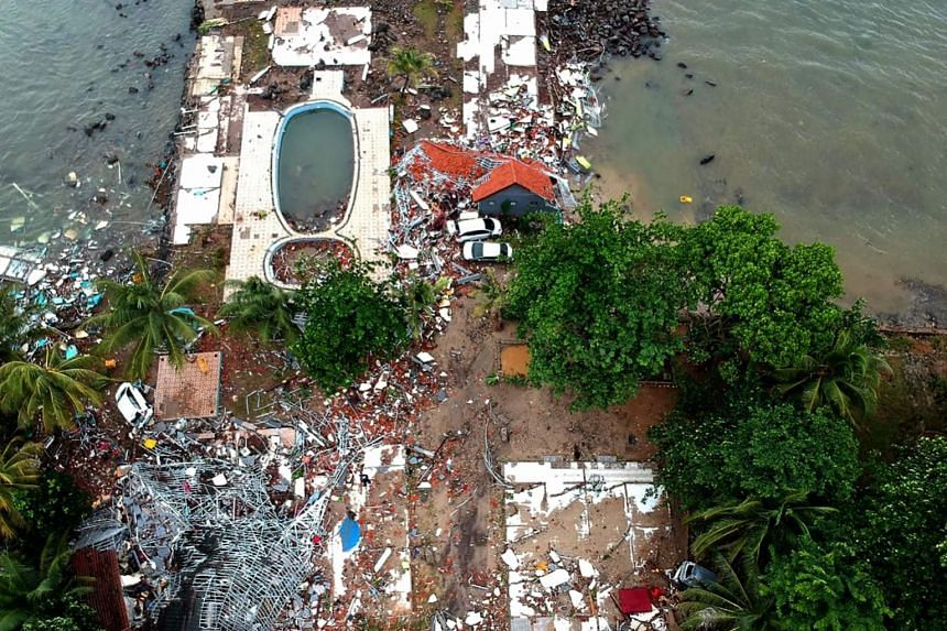 An aerial photo shows damaged buildings in Carita on Dec 23, 2018, after the area was hit by a tsunami on Dec 22 following an eruption of the Anak Krakatau volcano.