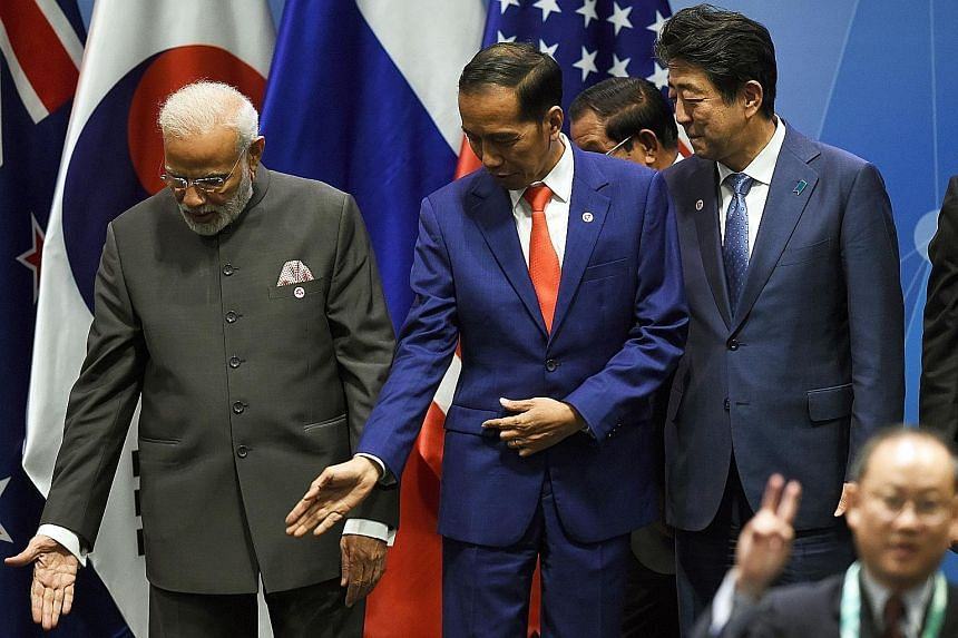 Indian Prime Minister Narendra Modi (left) and Indonesian President Joko Widodo face elections next year, and these have the potential to unnerve Asian credit markets if the incumbent leaders do not win as expected.
