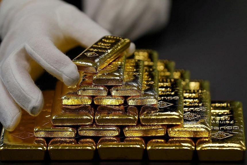 The Fed raised rates for the fourth time this year and lowered its forecast for hikes next year to two from three. Currency traders took the move as dovish, sending the dollar lower. That created a bullish spark for gold that sent prices above the 20