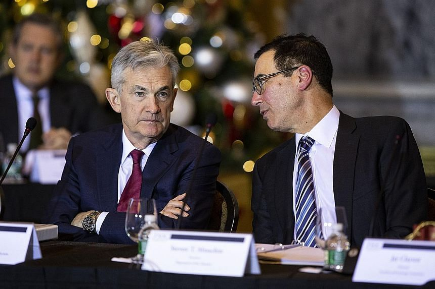 Wall Street is closely following reports that Mr Donald Trump has discussed firing Federal Reserve chairman Jerome Powell (left). Treasury Secretary Steven Mnuchin (right) said Mr Trump told him he had never suggested this.