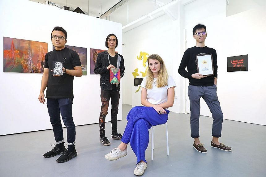 Artists (from far left) Farizwan Fajari, Ruben Pang and Loi Cai Xiang were among those involved in the advent calendar sale, led by Chan + Hori Contemporary director Lisa Polten (seated).