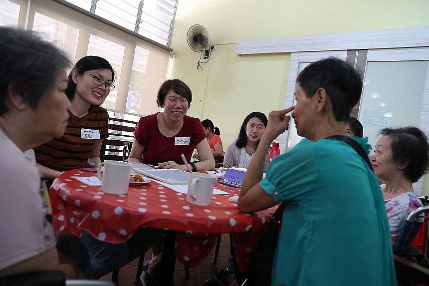 Volunteers singing Christmas carols and engaging participants at the Chit Chat Cafe session. The cafe is open one Saturday a month and orders are paid for with free vouchers issued to those who attend. Ms Evelyn Khoo (in red), who started Chit Chat C