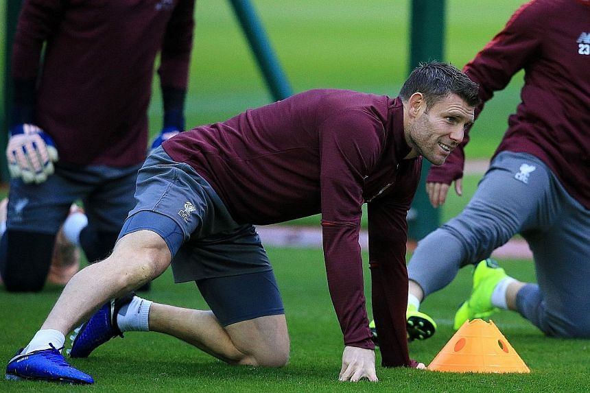 Liverpool midfielder James Milner says the Reds have enough experienced players to cope with the hectic festive schedule.
