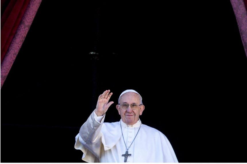 Pope Francis delivers the traditional Urbi et Orbi Christmas Day blessing from the central balcony of St Peter's Basilica at the Vatican,on Dec 25, 2018.
