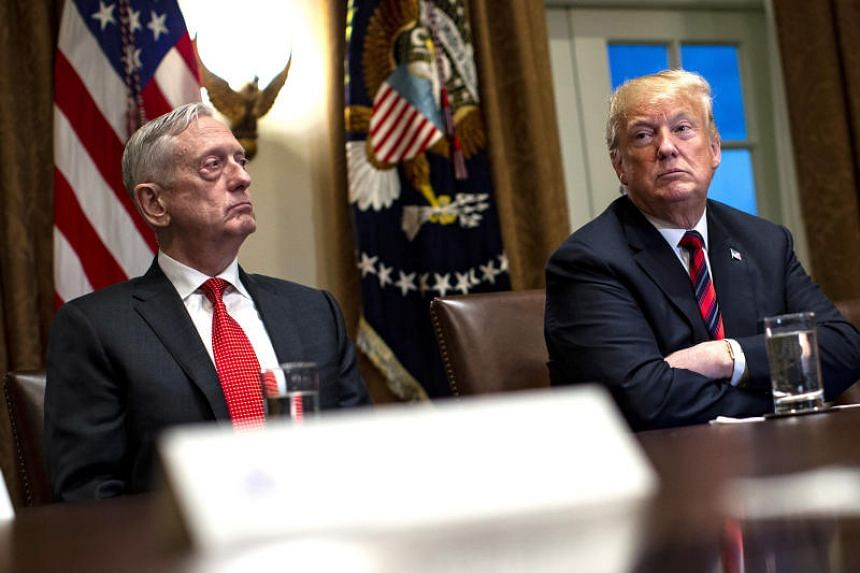 US President Donald Trump is seated next to Jim Mattis, US secretary of defense, during a briefing with senior military leaders in the Cabinet Room of the White House in Washington, DC, US, on Oct 23, 2018.