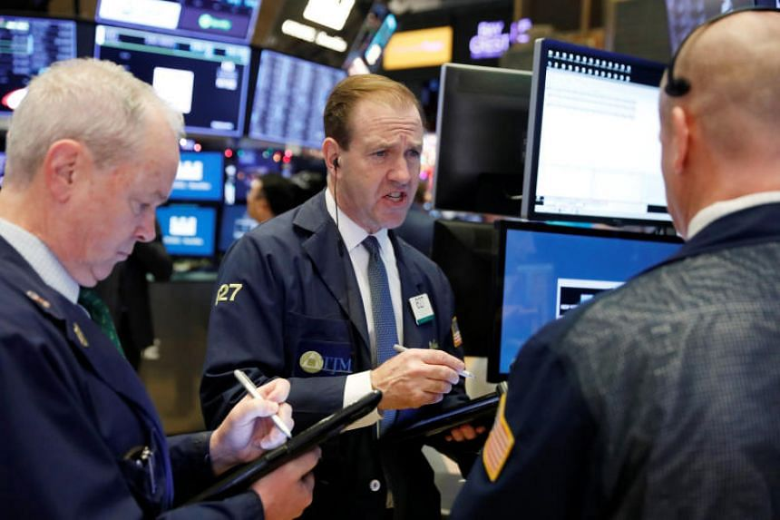 Traders work on the floor of the New York Stock Exchange shortly after the opening bell in New York, US, on Dec 24, 2018.