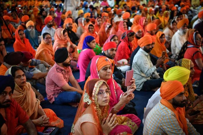 "People attending the Naam Ras Kirtan Darbar, which loosely translates to ""Festival of Sikh Music"", at the Singapore Expo, on Dec 25, 2018."