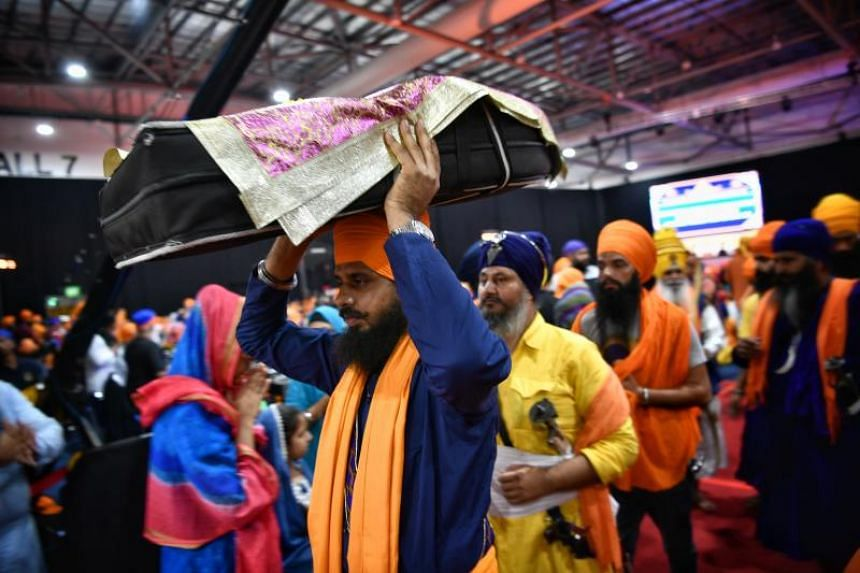 "People attending the Naam Ras Kirtan Darbar, which loosely translates to ""Festival of Sikh Music"", at the Singapore Expo on Dec 25, 2018."