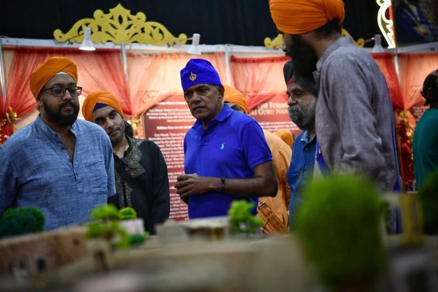 Law and Home Affairs Minister K. Shanmugam (centre) touring the exhibition area showcasing the Sikh culture at the Singapore Expo on Dec 25, 2018.