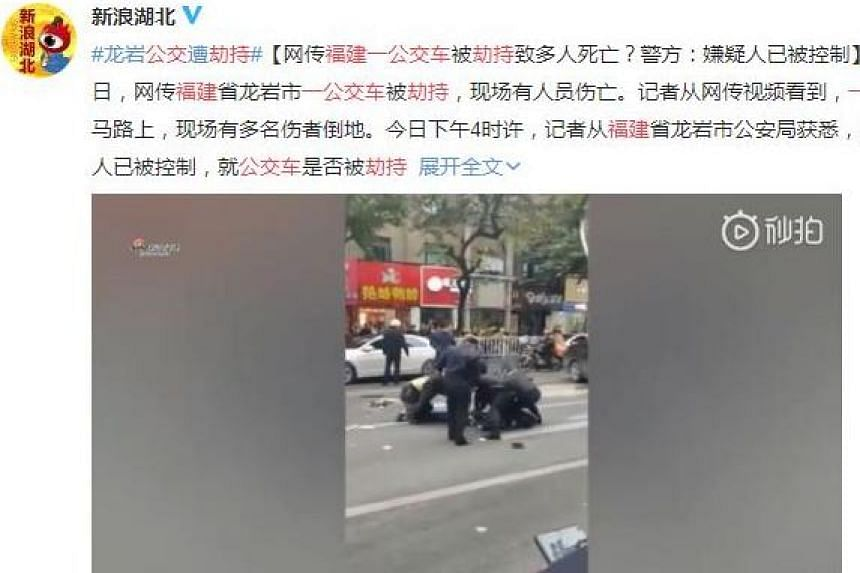 Police officers seen tackling the bus hijacker in Fujian, China, on Dec 25, 2018 in a video clip posted on micro-blogging site Weibo.