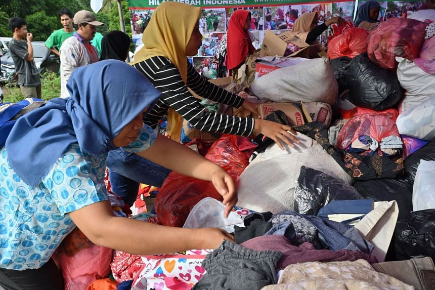 Tsunami survivors collect donated clothing at a help centre in Citangkil village in Sumur, Pandeglang, Banten province, Indonesia on Dec 25, 2018.