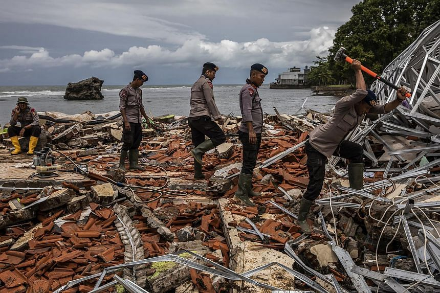 Clean-up and rescue operations taking place following a tsunami in Carita, Indonesia, on Dec 24, 2018.