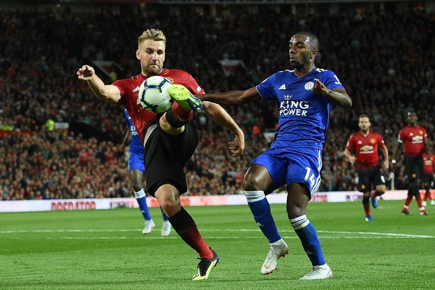 Manchester United's English defender Luke Shaw (left) scores the team's second goal past Leicester City's Portuguese midfielder Adrien Silva on Aug 10, 2018.