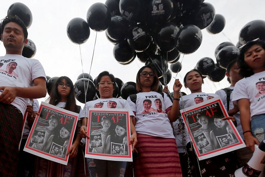 Activists in Yangon calling for the release of imprisoned Reuters journalists Wa Lone and Kyaw Soe Oo on Dec 12, one year after their arrest.