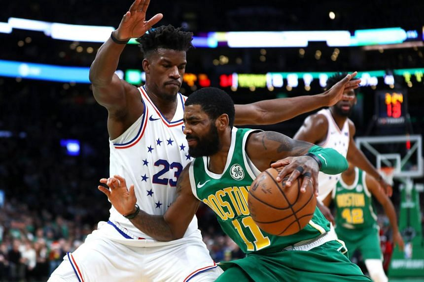 Boston Celtrics' Kyrie Irving (right) drives to the basket during the fourth quarter of the game on Dec 25, 2018.