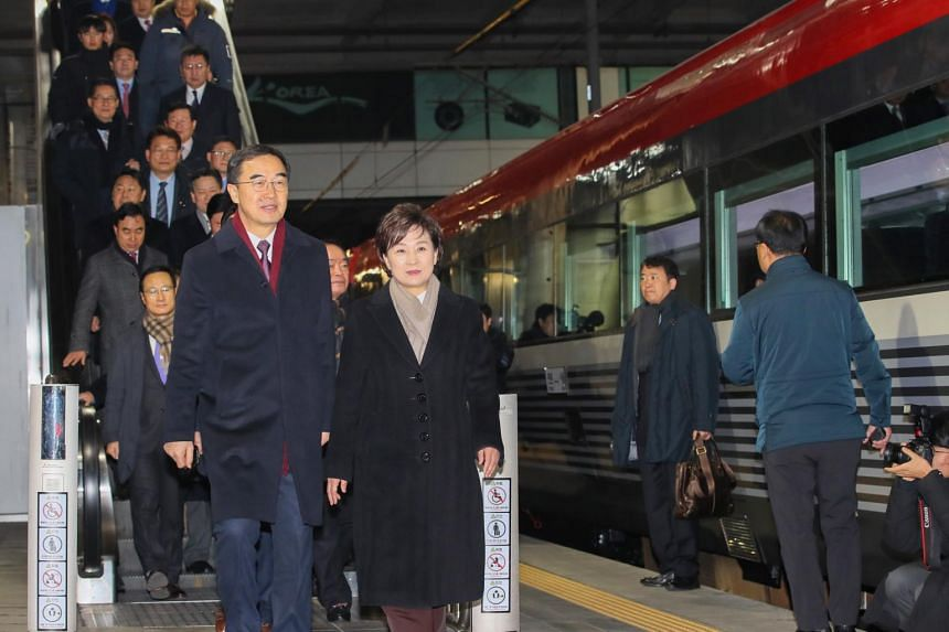 South Korea's Unification Minister Cho Myoung-gyon (left) and other officials heading to board a special train to Kaesong at Seoul Station, on Dec 26, 2018.