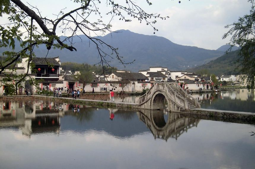 The railway links tourist hot spots such as the ancient village of Hongcun (pictured), Hangzhou, Huangshan and West Lake - all Unesco World Heritage Sites.