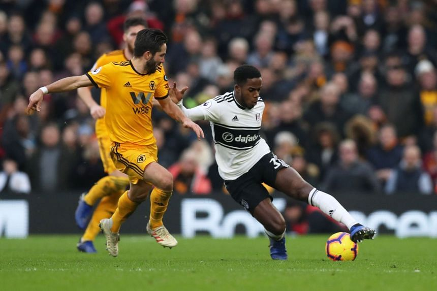 Fulham's Ryan Sessegnon (right) in action with Wolverhampton Wanderers' Joao Moutinho. The Wolves rescued a late 1-1 draw on in the match at Craven Cottage on Dec 26, 2018.