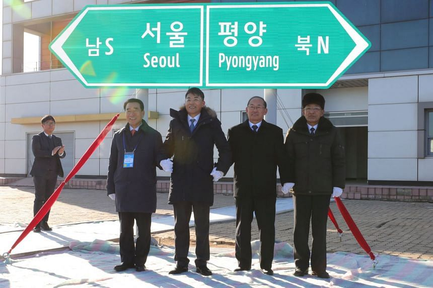 South and North Korean officials unveil the sign of Seoul to Pyeongyang during a groundbreaking ceremony for the reconnection of railways and roads at the Panmun Station in Kaesong, North Korea, on Dec 26, 2018.