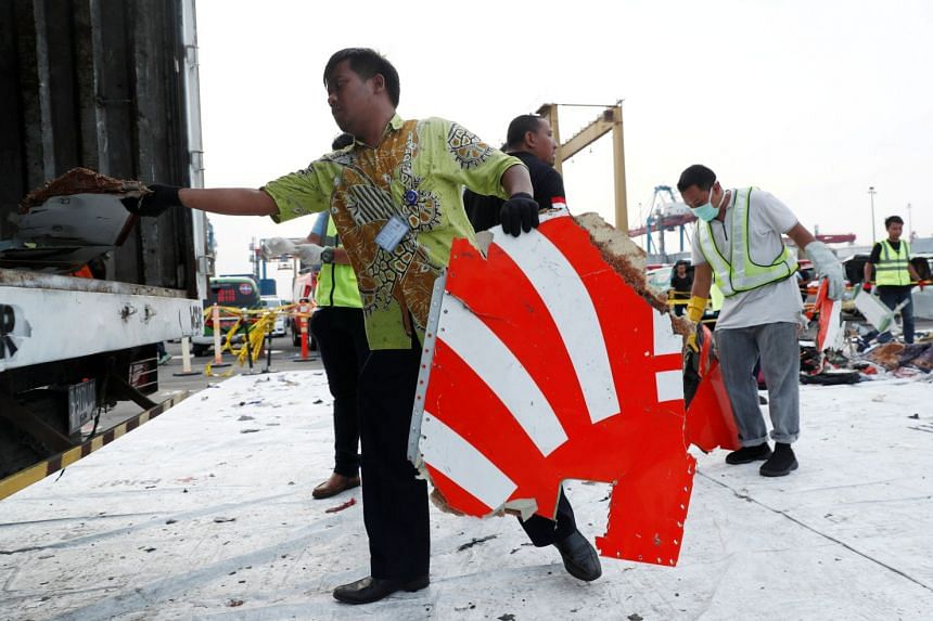 Workers load up recovered debris and belongings believed to be from Lion Air flight JT 610 onto a truck at Tanjung Priok port in Jakarta, Indonesia, on Nov 2, 2018.