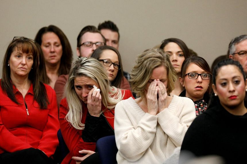 Victims look on at the sentencing hearing for Larry Nassar, a former team USA Gymnastics doctor who pleaded guilty to sexual assault charges, in Lansing, Michigan on Jan 24, 2018.