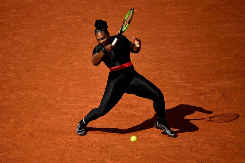 Serena Williams plays a forehand return on day three of The Roland Garros 2018 French Open tennis tournament on May 29, 2018.