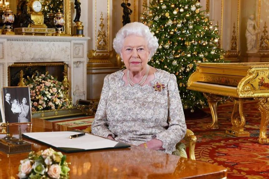 Britain's Queen Elizabeth II posing for a photograph after she recorded her annual Christmas Day message, in the White Drawing Room of Buckingham Palace in central London.