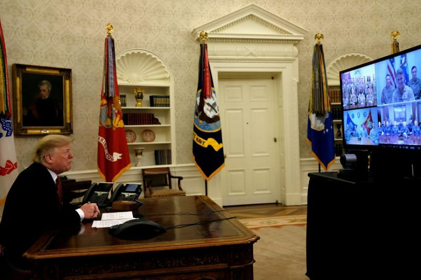 US President Donald Trump holds a video call with US military service members in the Oval Office on Christmas morning in Washington, on Dec 25, 2018.