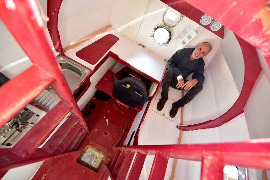 The living space includes a kitchen, sleeping bunk and storage, while a porthole in the floor allows Savin to look at passing fish.