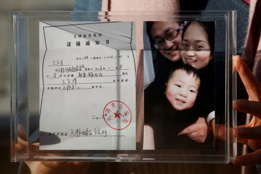 Li Wenzu, the wife of prominent Chinese rights lawyer Wang Quanzhang, holds a box with a family picture and the detention notice for her husband in Beijing, China, on Dec 17, 2018.