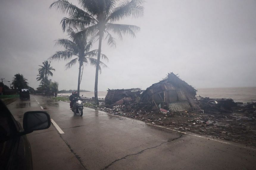 Debris seen along Anyer Beach as torrential rains pound villages in Banten, Indonesia, on Dec 26, 2018.