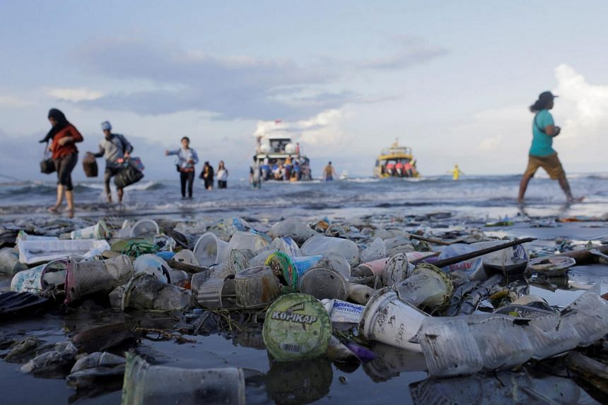 Passengers disembark a boat in Sanur, Denpasar, Bali, on April 10, 2018. Experts estimate that up to 80 per cent of the rubbish on Bali's beaches comes from the island.