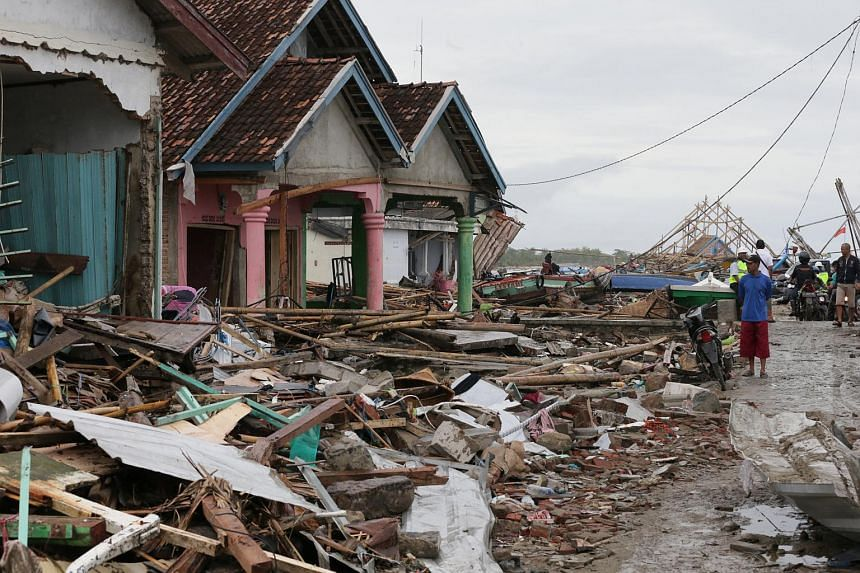 Debris at a remote village at a sub regency in Banten, Indonesia. Collasped bridges, rubble and fallen tress are hindering the logistical efforts to provide aid.